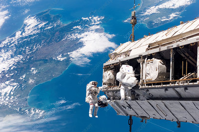 Astronauts performing spacewalk