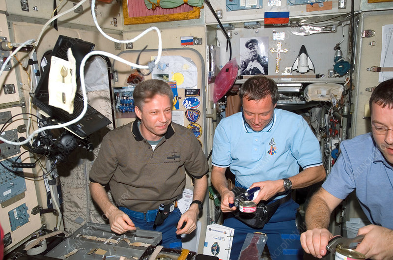 Astronauts eating during shuttle mission