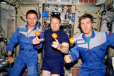 ISS astronauts about to eat oranges
