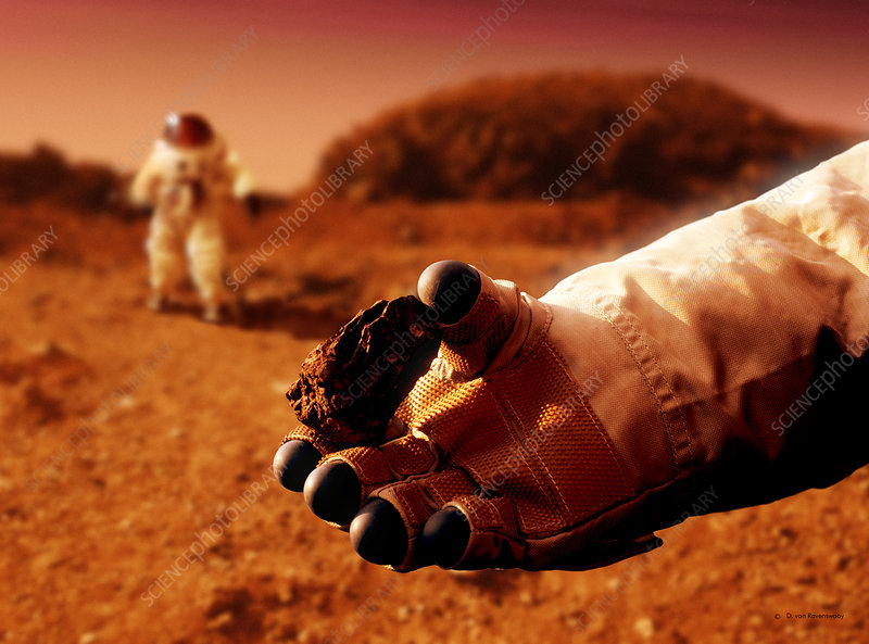 Astronaut holds Martian rock