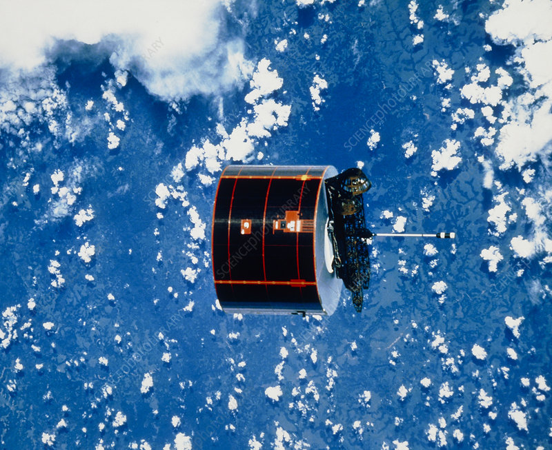 The Syncom IV-5 communications satellite in orbit