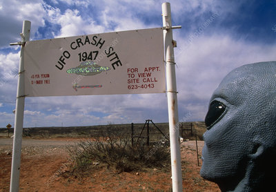 Alien figure at sign near UFO crash site, Roswell