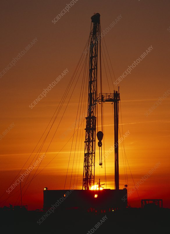 Sunset at an onshore gas drilling rig