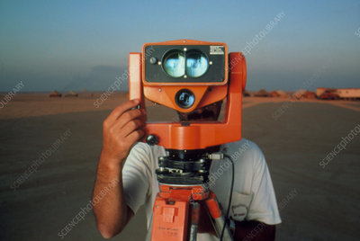 Man with a survey instrument in the Libyan dessert