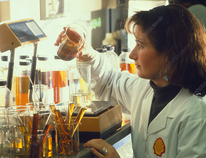 Female technician preparing oil samples.