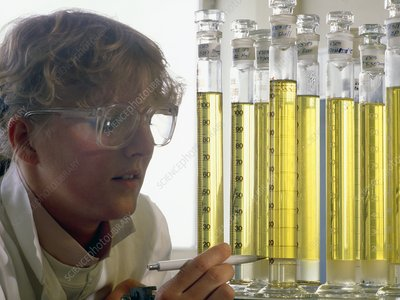 Female technician with oil samples.