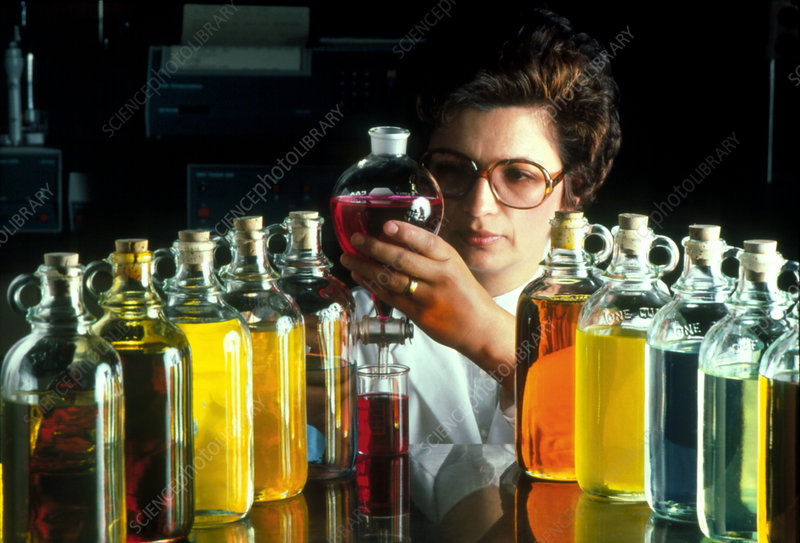 Technician with containers of oil samples.