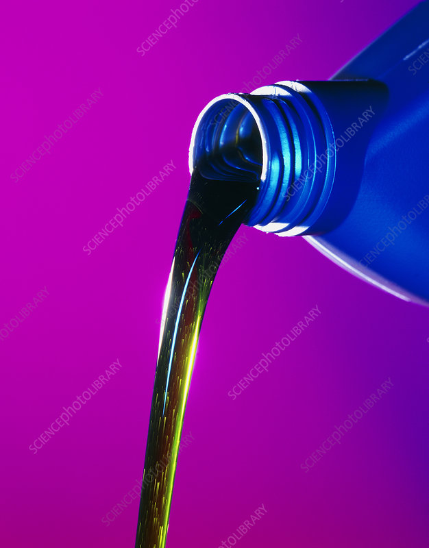 View of lubricating oil pouring from its bottle