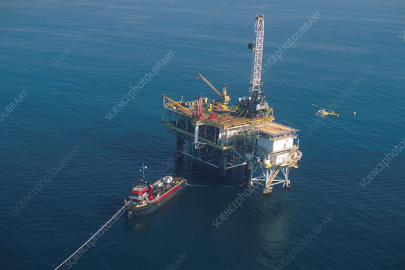 Helicopter landing on oil rig