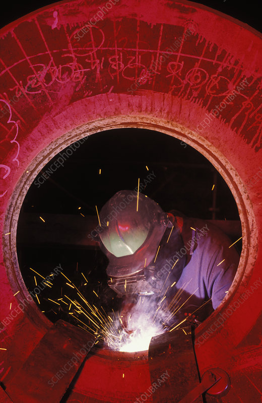 Welder working on a flange