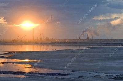 Oil refinery near sunset
