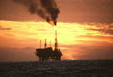 Oil production platform in North Sea at sunset