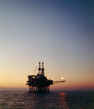 View of an oil rig in the North sea at sunset