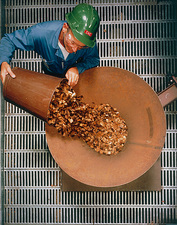 Woodchips being fed into a reactor to make methane