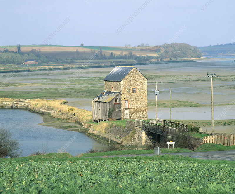 Traditional tidal mill on a river estuary