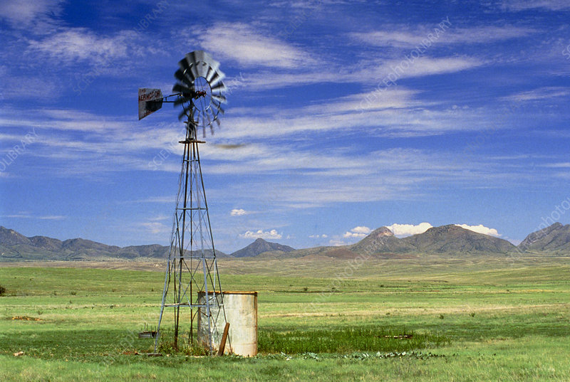Windmill on prairie land, New Mexico
