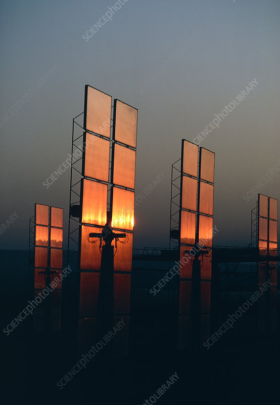The light of sunset on mirrors of solar power stn.