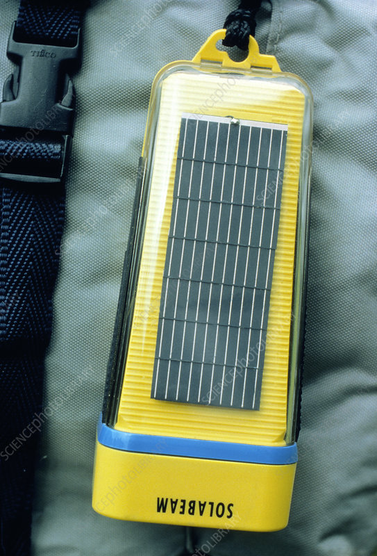 Solar powered torch on a backpack