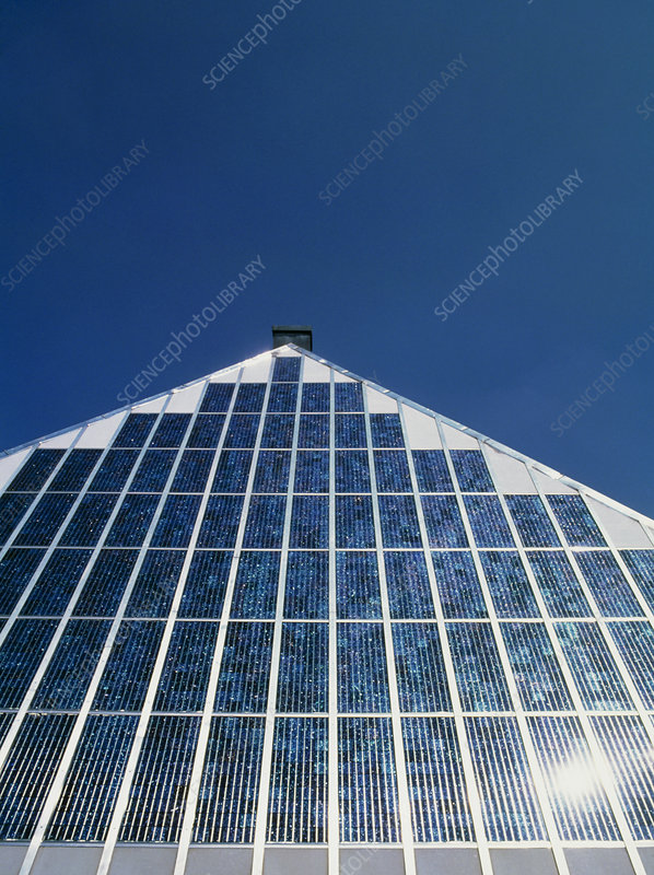 An array of photovoltaic cells on a roof.