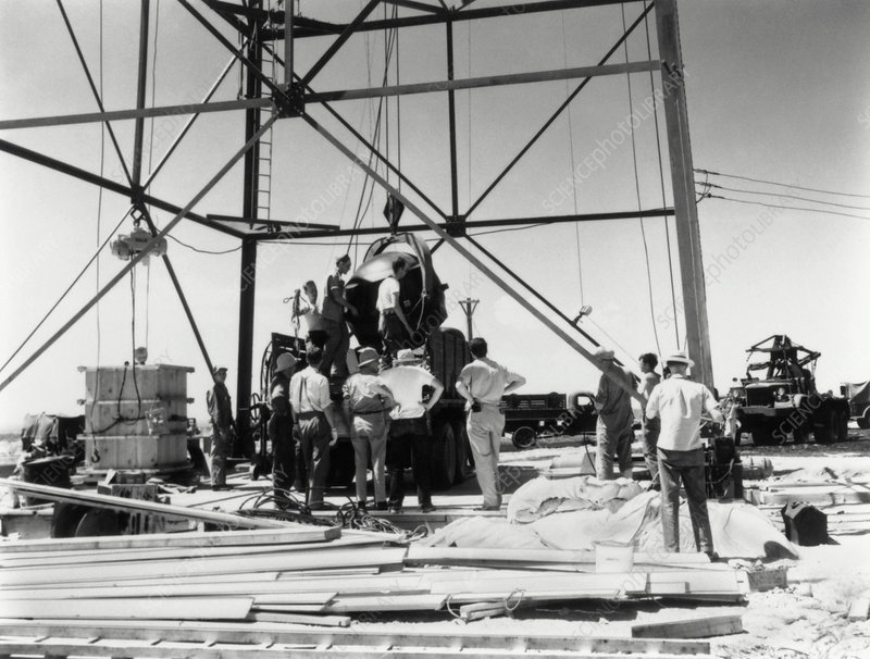 The Trinity atom bomb being raised onto tower