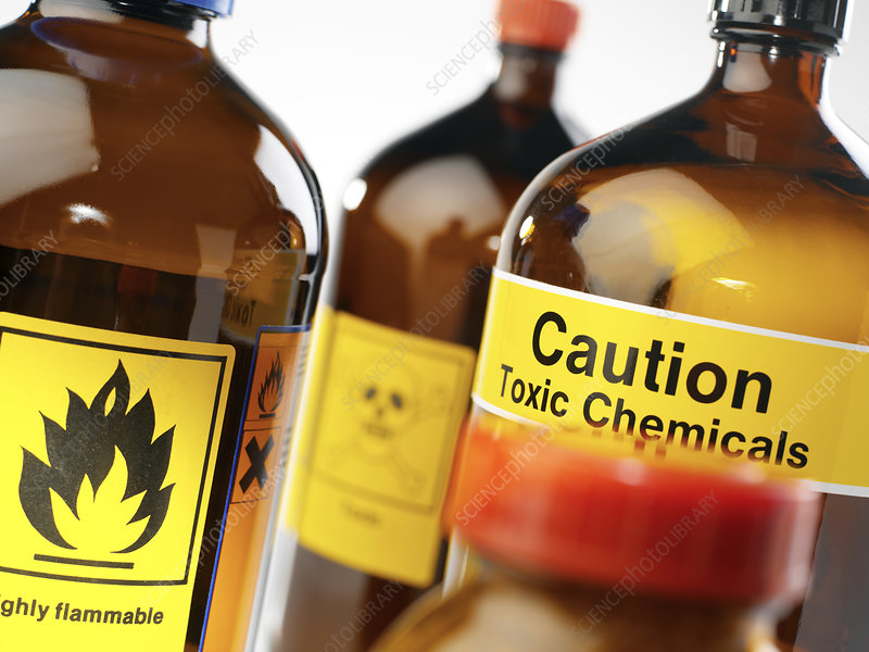 Caption hazardous chemicals containers labelled with chemical hazard