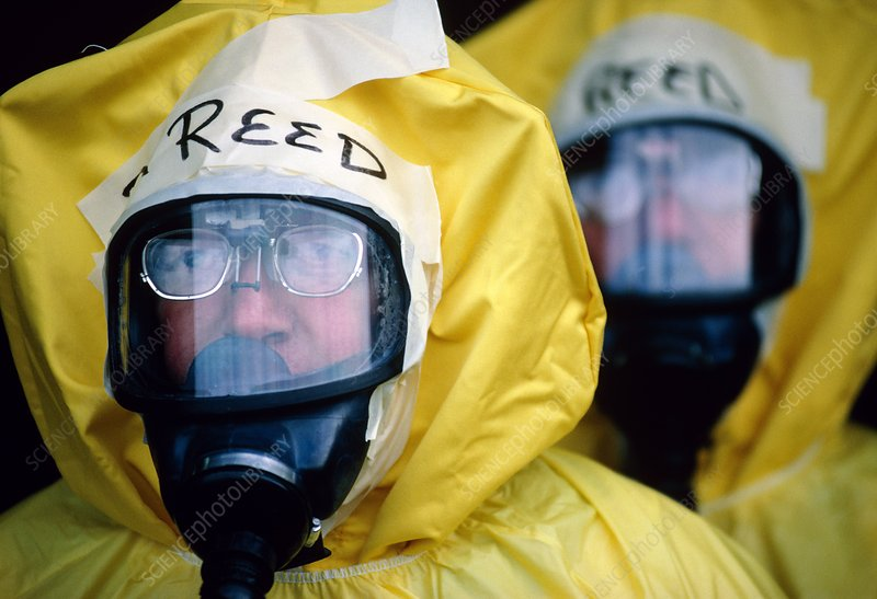Decontamination workers in protective clothing