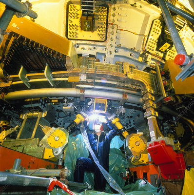 Engineer working on tokamak fusion reactor at JET