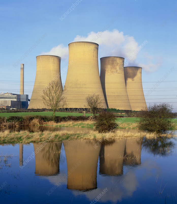 View of a power station reflected in flooded field