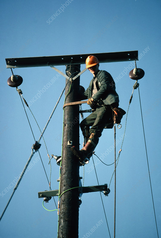 Engineer working on electricity power lines.