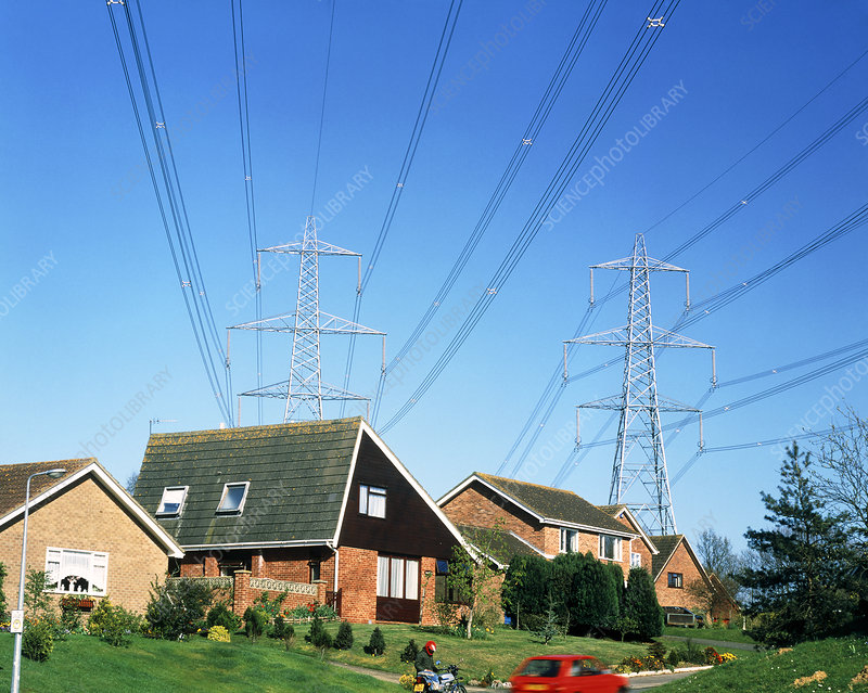 Power cables and pylons over homes