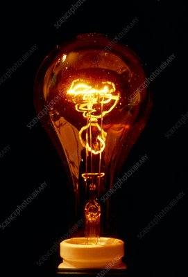 A tungsten electric light bulb switched on