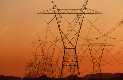 Electricity pylons & transmission lines at sunset