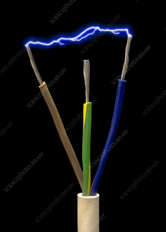 Wires of a 3-pin plug showing spark discharge - Stock Image T194