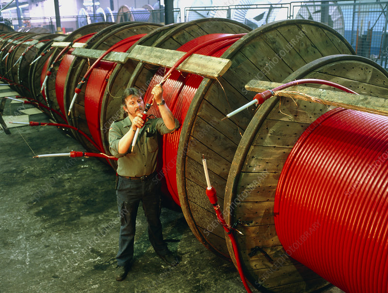 Worker tests reels of electric cable