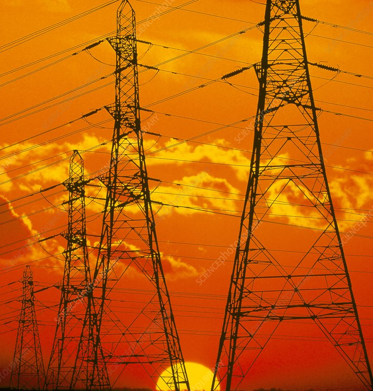Pylons carrying electricity wires at sunset - Stock Image T194 ...