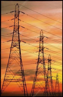 Pylons carrying electricity wires at sunset