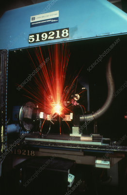 Use of laser to drill holes in jet engine turbine