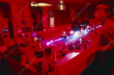 Scientist observing beam from tunable dye laser
