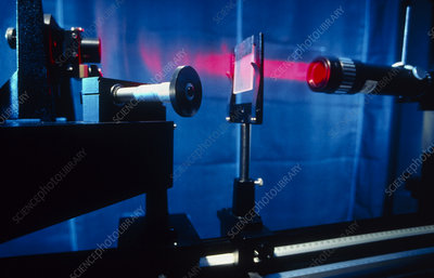 Laser on optical bench in laboratory