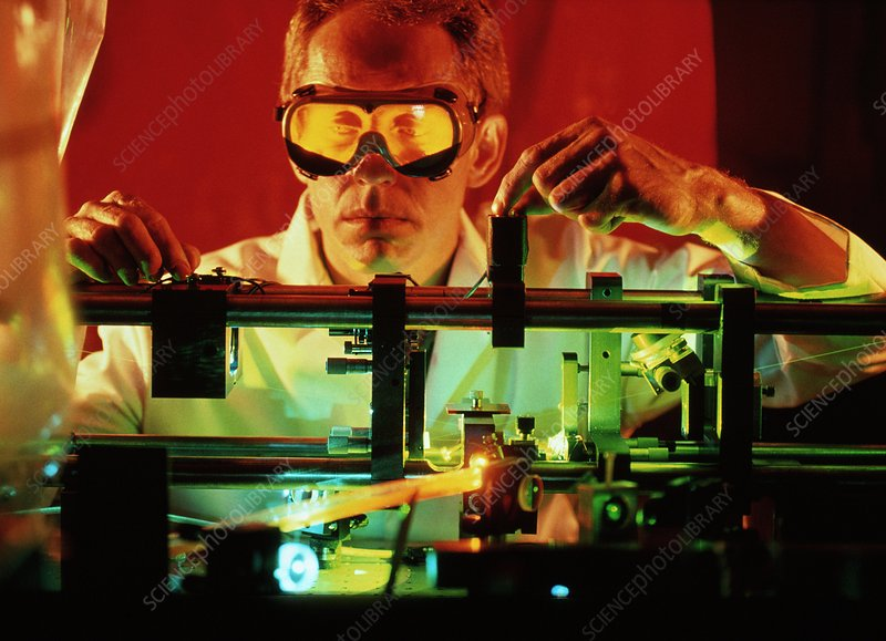 Researcher with dye laser used in an atomic clock