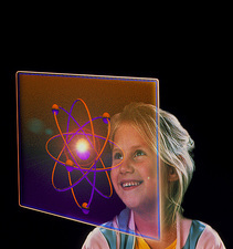 Child looking at holographic image