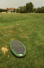 View of solar-powered robot lawnmower in action