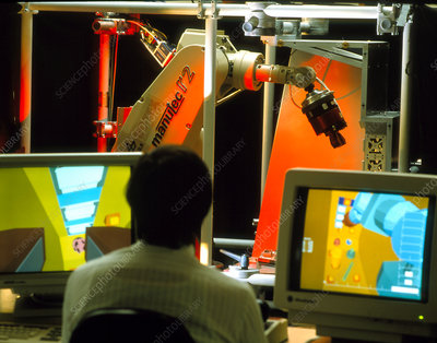 Technician working with the ROTEX robot arm