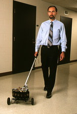 Johann Borenstein with his Guidecane robot