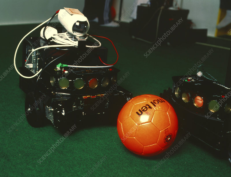 Two robots go for a ball at RoboCup-98 in Paris