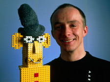 Researcher with his happy emotional Lego robot