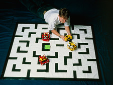 Researcher testing Lego robots playing Pacman