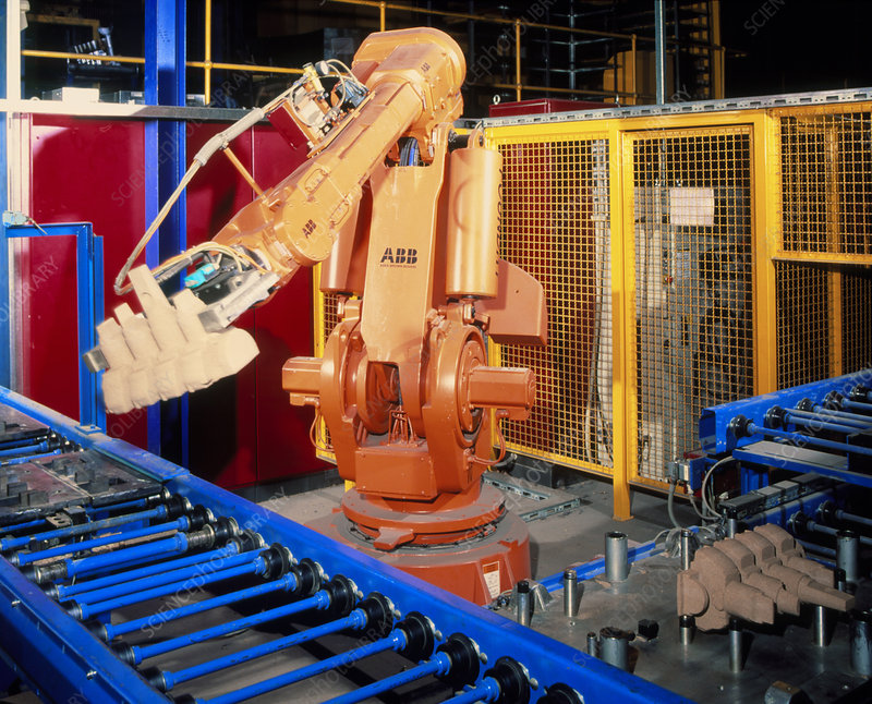 Robot arm transferring car engine block moulds