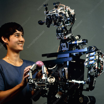 Technician with the android robot Cog