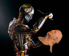 SARCOS android robot paints a life-like robot mask